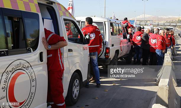 A Red Crescent convoy prepares to leave Damascus to the besieged areas of Madaya and Zabadani on February 17 2016 during an operation in cooperation...