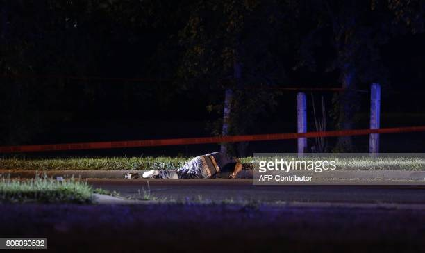 Red crime tape scene surrounds a man who was shot and killed on the Near West Side on July 2 2017 in Chicago Illinois Local media reports that at...
