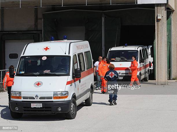 Red Cross' ambulances carry bodies to a butcher cold storage room where a temporary morgue was set up for those awaiting identification on April 8...