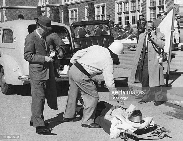 MAR 21 1959 MAR 22 1959 Red Cross Civil Defense workers move 'Disaster Victim' Horriet Stark of 1371 Olive St a senior at East High rests on...