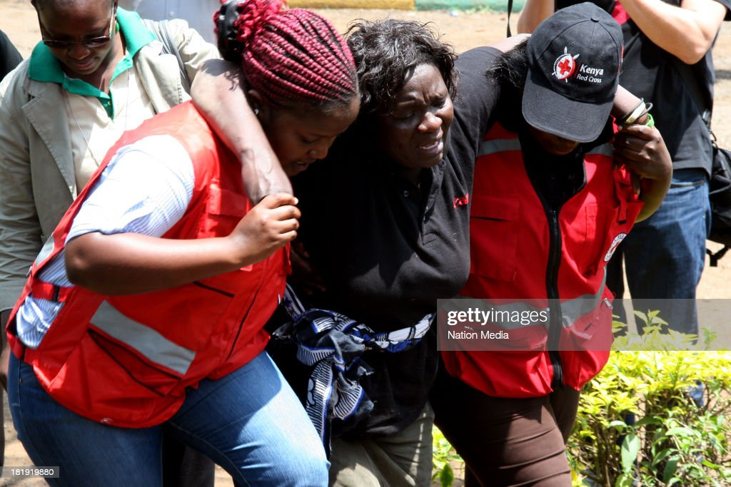 Red Cross Counsellors help a women overcome by grief after having to identify a body of a victim of the Westgate Mall on September 25, 2013 in Nairobi, Kenya. The Mall was hit with a terrorist attack on Saturday, 10-15 gunmen from the extremist group Al-Shabab entered the mall and opened fire at random on shoppers; 68 deaths have been confirmed.