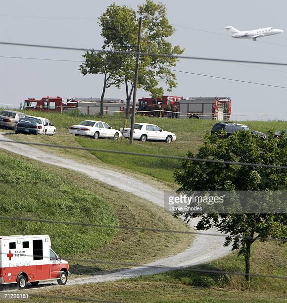 Red Cross Disaster Relief truck drives up the road to the crash site of Comair Flight 5191 that crashed shortly after departure from Blue Grass...