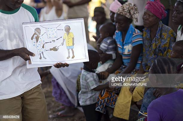 A Red Cross member informs villagers on how to avoid child Conjunctivitis on January 25 2014 in Leo Burkina Faso The French cosmetics company...