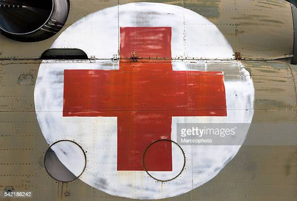 Red cross sign painted on some old helicopter side
