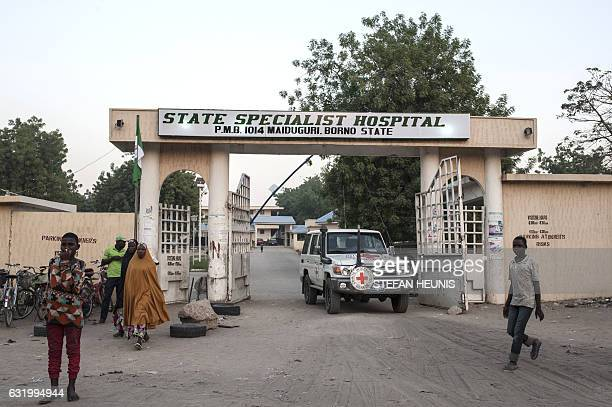 A Red Cross vehicle leaves the Maiduguri State Specialist Hospital grounds on on January 18 2017 At least 70 people have died in an Internally...