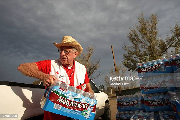 Red Cross volunteer Bill Hawkins distibutes drinking water to residents October 29 2007 in Ramona California A ban on the local water supply in...