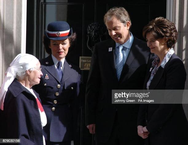 Red Cross volunteer Madge Dobinson and Lady Newall President of the London Branch of the Red Cross meet Prime Minister Tony Blair and his wife Cherie...