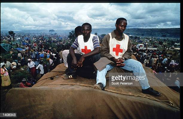 Red Cross volunteers rest at the United Nations camp for Rwandan refugees April 30 1994 in Ngara Tanzania Most of the camp''s 250000 people are...