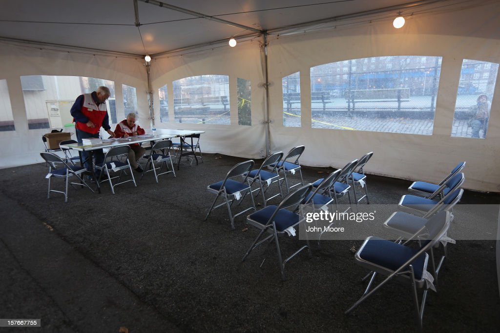 Red Cross volunteers staff an empty disaster relief center in the Red Hook neighborhood of Brooklyn on December 5, 2012 in New York City. More than a month after superstorm Sandy flooded the area, the immediate disaster relief effort may have passed, but many homes and businesses remain closed pending repairs.