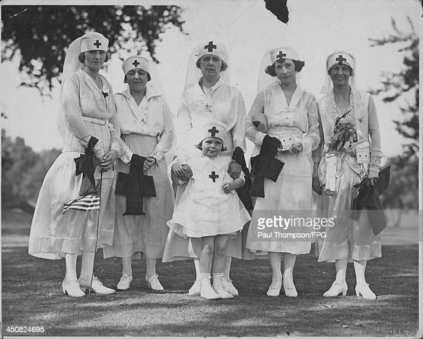 Red Cross women holding American flags following a presentation during World War One USA circa 19171919