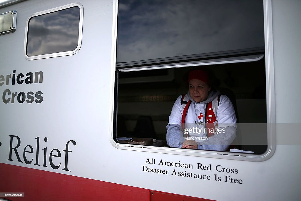 Red Cross worker Barbara Noble waits to give out free coffee to victims of Superstorm Sandy on November 25, 2012 in Seaside Heights, New Jersey. New Jersey Gov. Christie estimated that Superstorm Sandy cost New Jersey $29.4 billion in damage and economic losses.