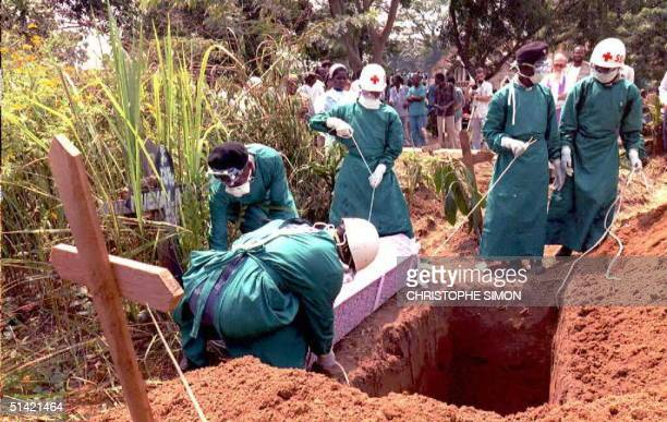 Red Cross workers burry 14 May Italian nun Dinarosa Belleri at the Kikwit cemetery 320 miles southeast of the Zairean capital Kinshasa Belleri a...