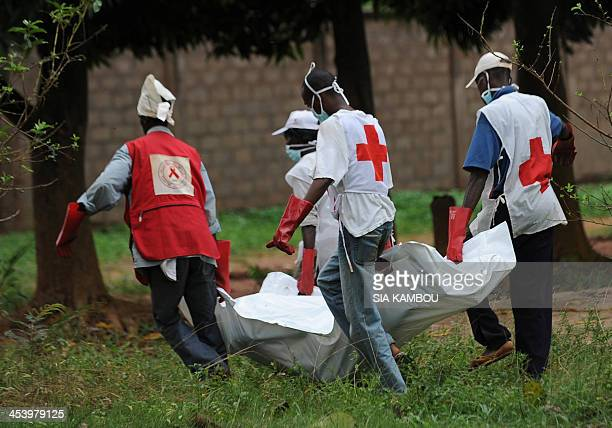 Red Cross workers retrieve a body from the site of clashes in Bangui on December 6 2013 French troops have killed several armed fighters in the...