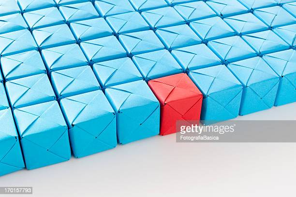 Red cube between blue ones