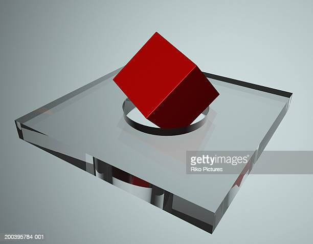 Red cube on circular hole in glass block (digital)