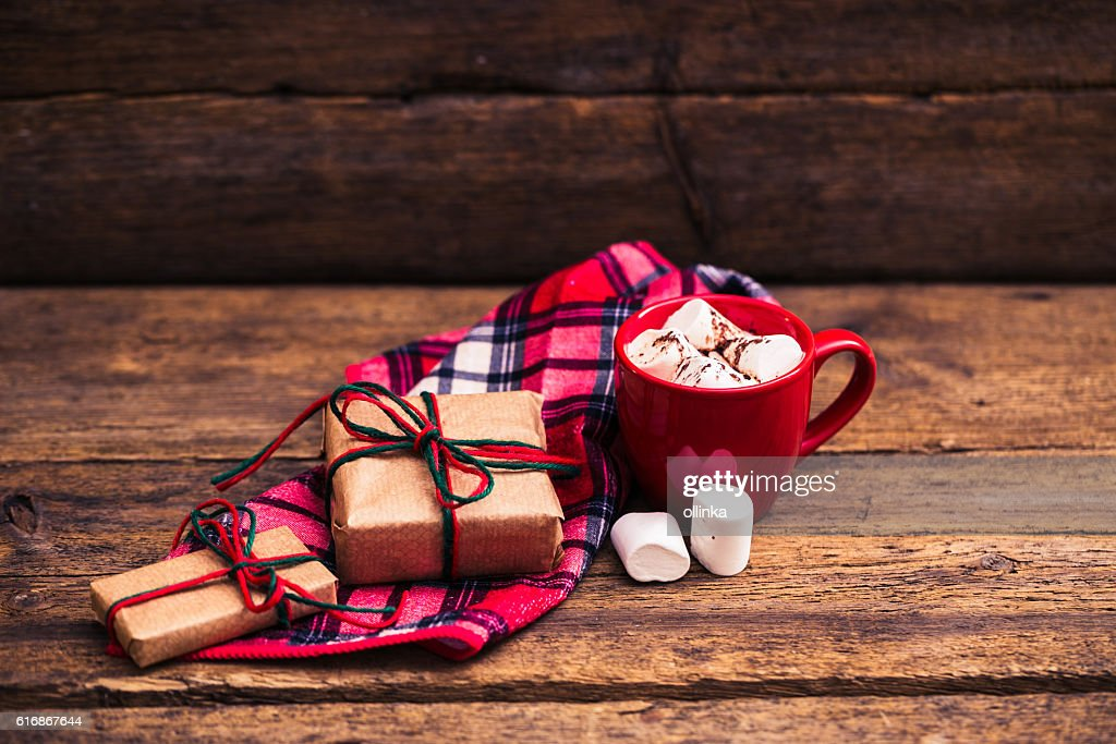 red cup with cocoa and marshmallows on wooden background : Stock Photo