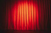 Red curtain illuminated with spotlight