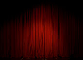 The Red Curtain in the theater is illuminated with a single reflector