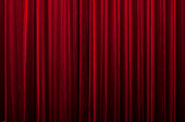 close-up of a closed red velvet curtain in theater