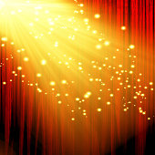 red movie or theater curtain with a bright spotlight with glitters and sparkles