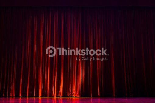 Red curtains with the lights of the show and the wood flooring parquet. : Stock Photo