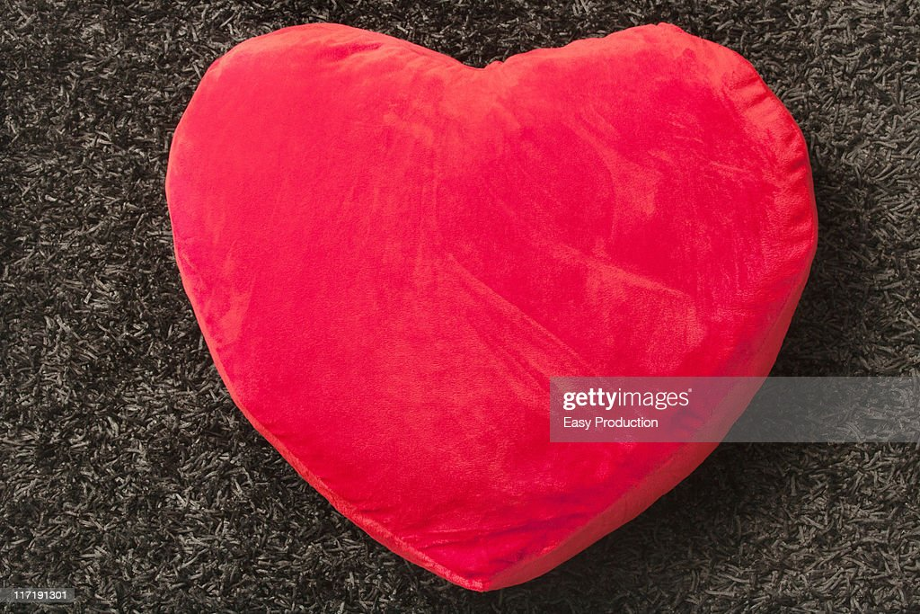 red cushion with a heart shape