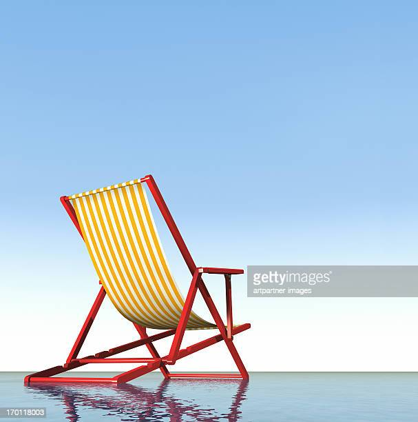 A Red Deck Chair at the sea with blue sky