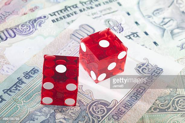 Red dice on Indian bank notes