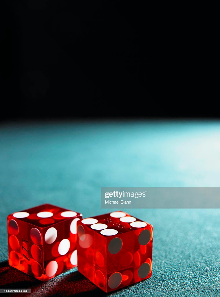 Red dice on table : Stock Photo