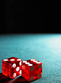 Red dice on table