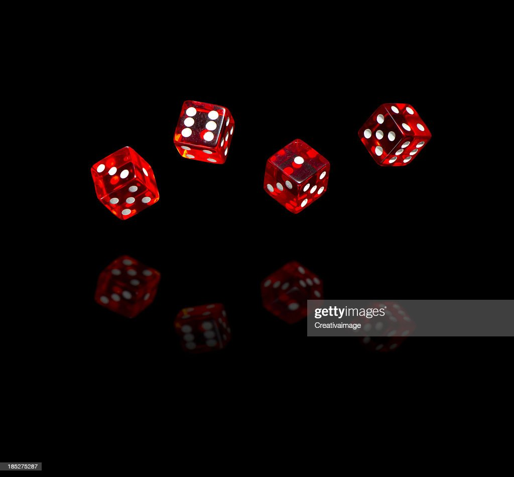 Red dices on black background
