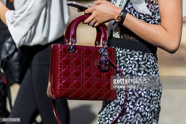 A red Dior bag outside Georgia Alice at MercedesBenz Fashion Week Resort 17 Collections at Carriageworks on May 16 2016 in Sydney Australia