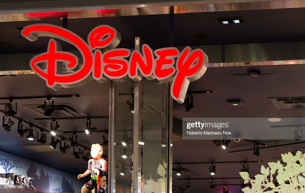 Red Disney signage inside a shopping mall placed near the ceiling close to light tracks