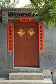 Red door entrance, China, Beijing, Hutong