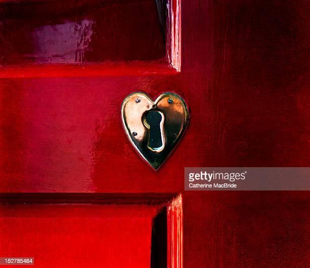 Red door with heart shaped lock