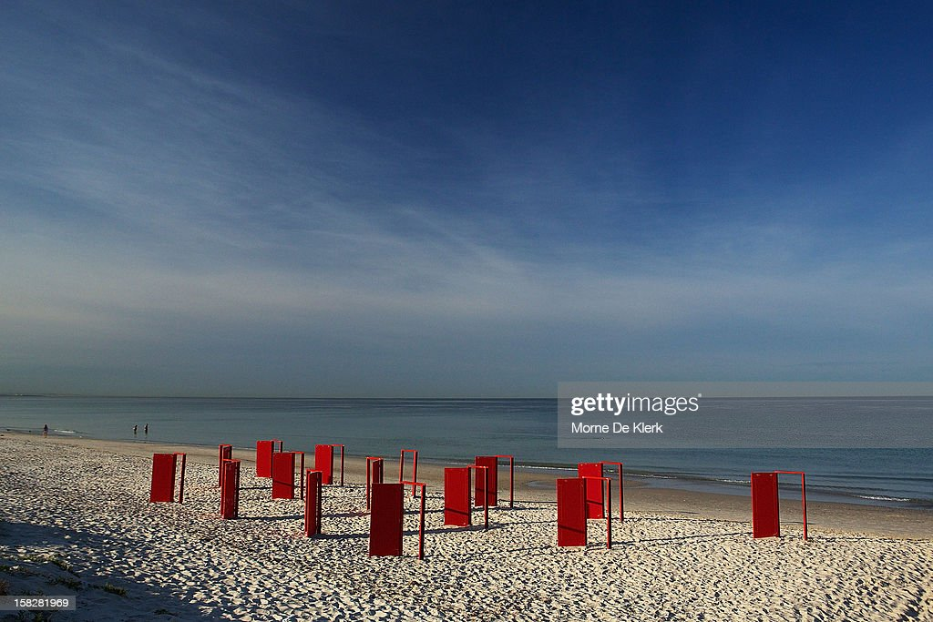 Red doors stand on the beach before being used in an installation by surrealist artist, Andrew Baines at Henley Beach on December 13, 2012 in Adelaide, Australia. The installation was called 'Doorways To Potential'.