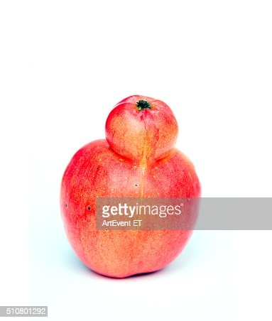 Red double Conjoined apple on white background : Stock Photo