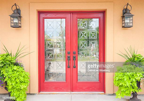 Red double doors in a Aztec styled home