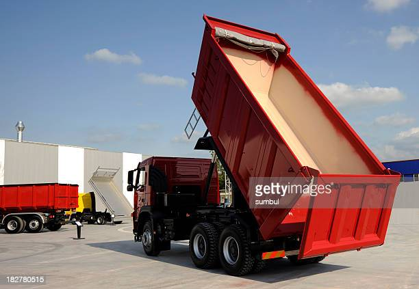 Red dump truck with an empty bed