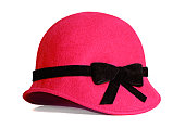 Red felt hat with black ribbon. Winter autumn fashion item image.