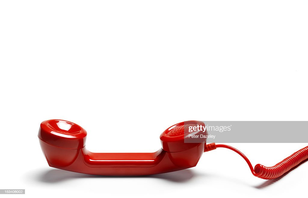 Red emergency phone left of the hook : Stock Photo
