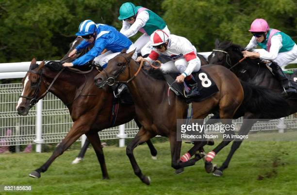 Red Evie ridden by Frankie Dettori wins the Oak Tree Stakes at Goodwood racecourse