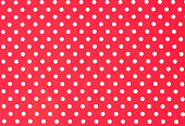Cloth background texture of white dotted red textile