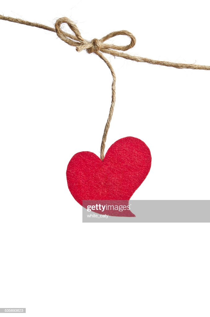 Red fabric heart hanging on the clothesline : Stock Photo