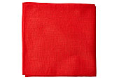Red fabric napkin isolated on white background