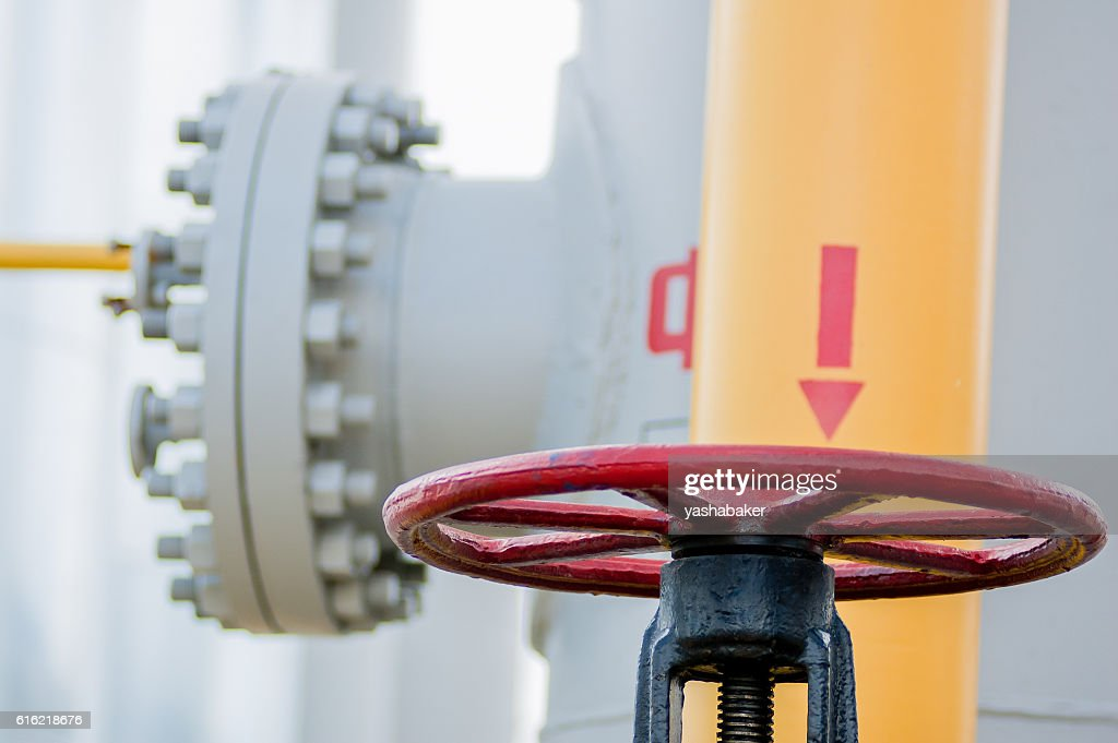 Red faucet with steel pipe in natural gas treatment plant : Stock Photo