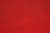 Red felt table surface extremal close up. Large macro texture and background