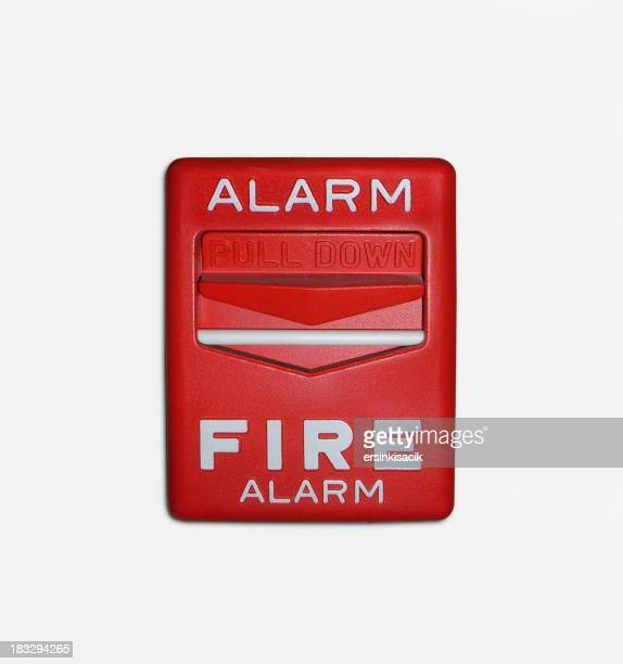 Red fire alarm trigger over a white background