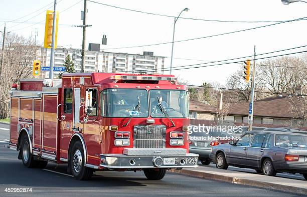 Red fire truck rushing to a possible fire sirens and lights on to get free way in the city transit