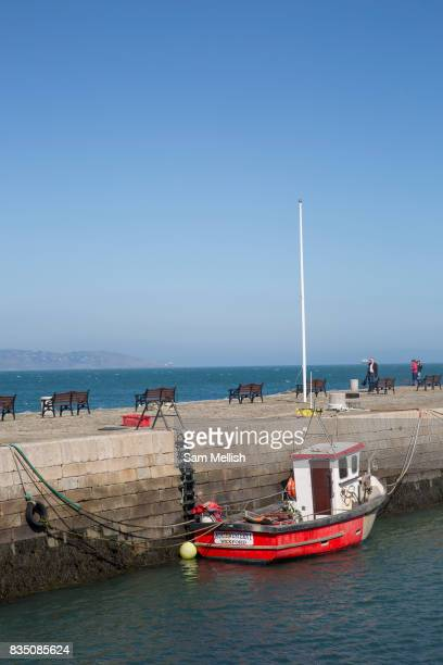 A red fishing boat at Bullock Harbour in Dalkey on 08th April 2017 in County Dublin Republic of Ireland Dalkey is one of the most affluent suburbs of...